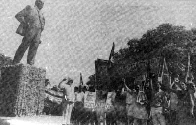 Senior members of Communist Party of India (M) giving the red salute near the statue of Lenin in Delhi